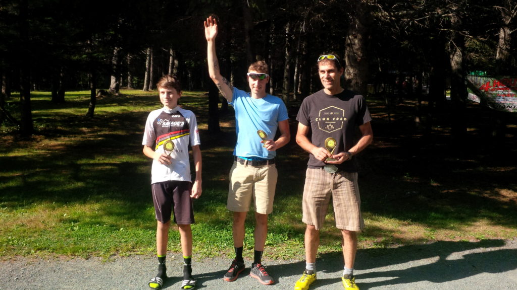 Rioux, Roussel, and Babineau. XCM Champions